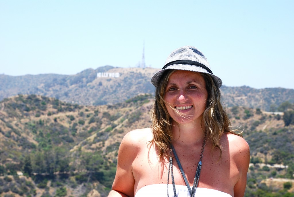 GRIFFITH PARK GIRL IN A HAT WITH HOLLYWOOD SIGN BEHIND