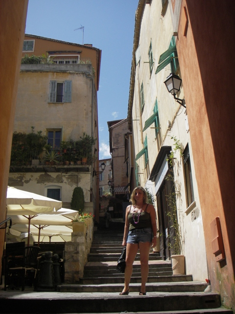 Girl posing on the steps up Villefranche