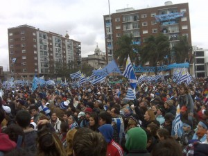 A sea of people with Uruguayan flags on MOntevideo streets
