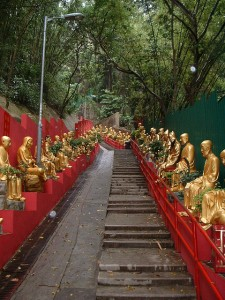 Path lined with golden buddhas